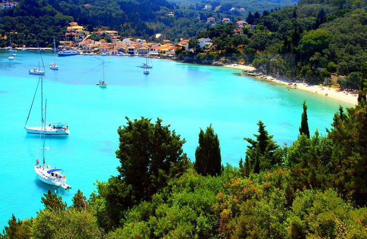 https://flic.kr/p/5d9yLF | Lakka Bay, Paxos island | Turquoise water with sails, narrow beach and mediterranean town. Lakka, Paxos island, Ionian islands, Greece