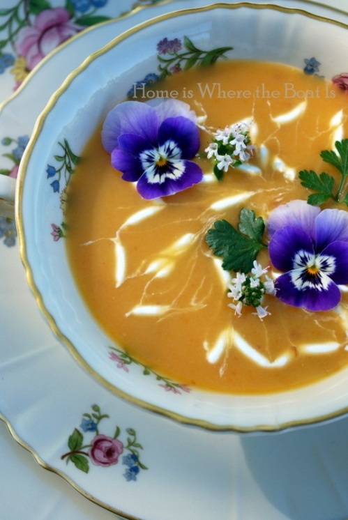 Cold carrot soup w/sour cream swirls & pansies - might be good on a hot summer's day? I'll have to try and see