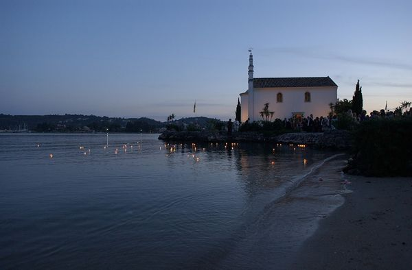 Floating chapel | Corfu  Keyhole View: Wish candles lighted by the guests color the blue canvas.