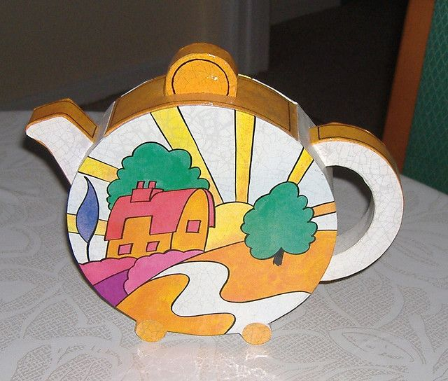 Clarice Cliff. This one reminds me of Peter Max or Yellow Submarine!