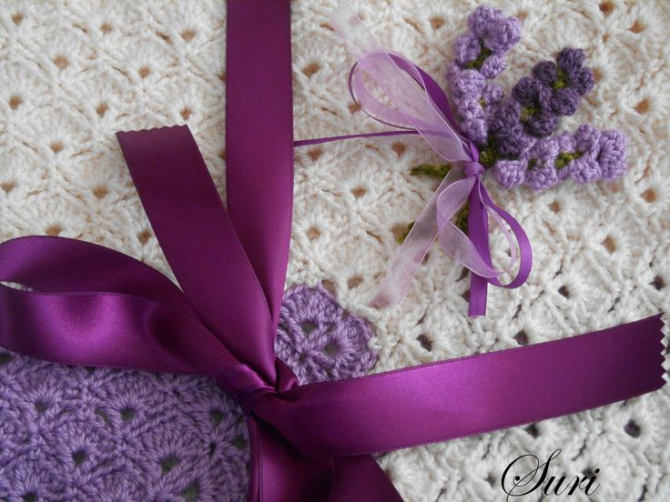 Crochet flowers on baby blanket