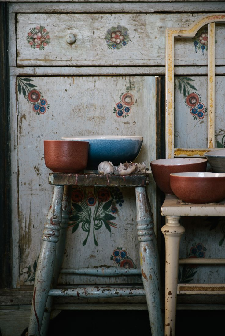 Beautifully patterned antique cupboards, stools and handmade ceramics