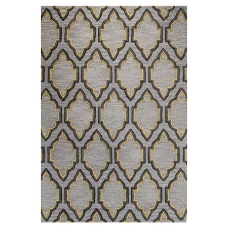 Wool rug with a lattice motif. $283 for an 8x10'. Hand-tufted in India.  Product: RugConstruction Material: 100% WoolCo...