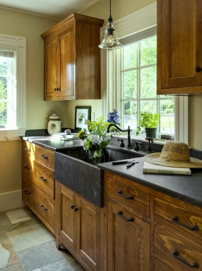 Neutral Kitchen With Wood Cabinets and Dark Stone Farmhouse Sink