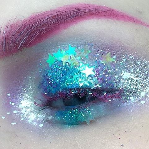 Pink eyelashes and eyebrows with blue glitter eye shadow (from: space-grunge.tumblr.com)--LOVE!