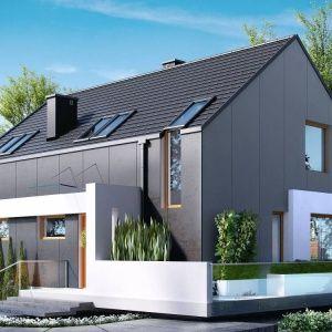HomeKONCEPT 17 to bardzo nowoczesny budynek jednorodzinny, parterowy z poddaszem użytkowym, który wyróżnia się atrakcyjną, minimalistyczną bryłą, pokrytą grafitowymi płytami elewacyjnymi i zwieńczony dachem bezokapowym.