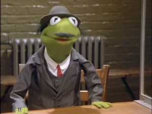 """Kermit disguised as Rosenthal, Miss Piggy's lawyer in """"The Great Muppet Caper""""."""