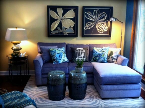 Transitional Sitting Area With Gray Sectional Drum Stools And Zebra Rug Interior Design Omaha