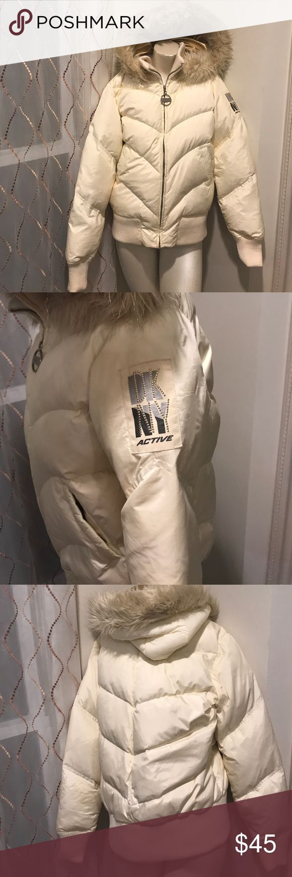 DKNY ACTIVE women's puffer jacket White with gold interior and logo on one sleeve. Great condition minus two small stains on back as shown in pictures. Faux fur accented hood. A pretty and warm coat. Dkny Jackets & Coats Puffers