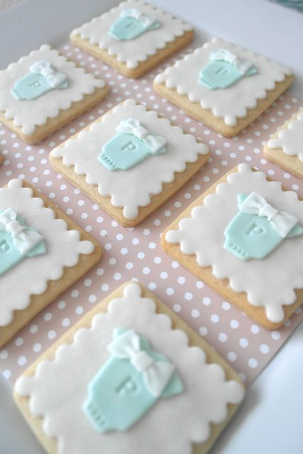 Adorable fondant toppers on square cookies at a baby shower!   See more party ideas at CatchMyParty.com!
