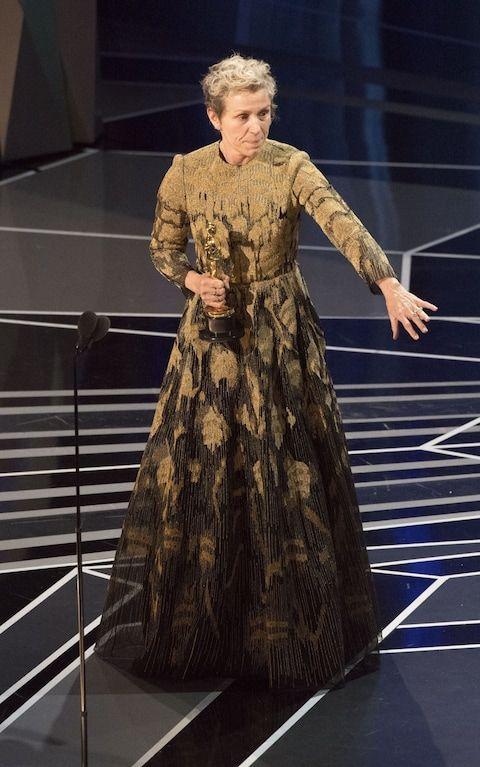 Frances McDormand accepting her Best Actress award wearing a gold intarsia dress. She mostly wore Valentino to awards this season.