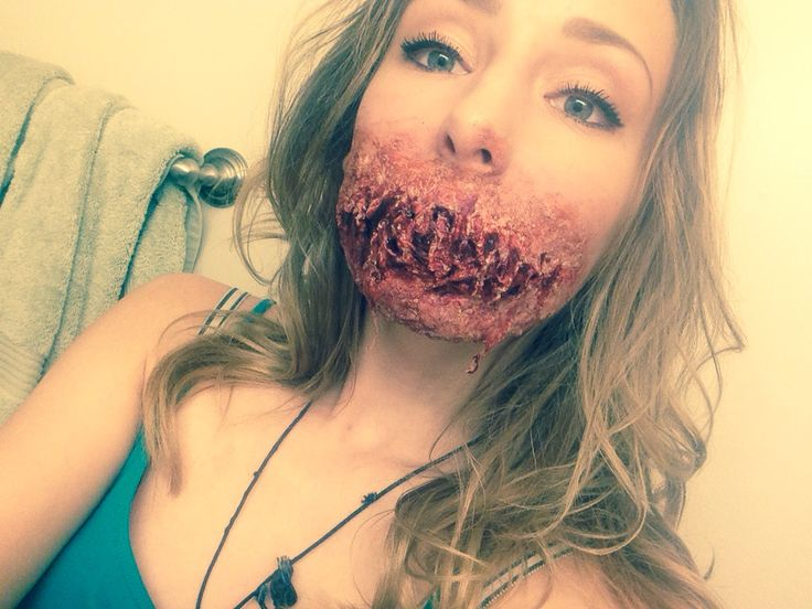 Halloween makeup gore! I did this a couple nights ago with latex and tissue (fake blood, red lipstick and other items) zombie wound. Inspired by glam and gore (: scary