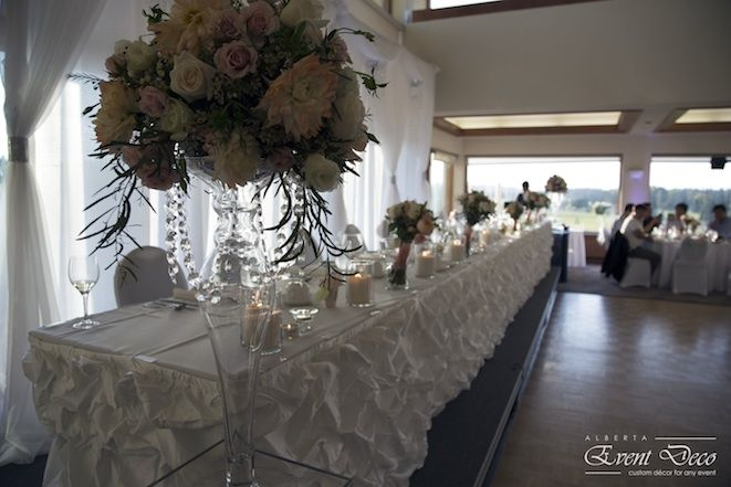 Head Table with tall arrangements on each side