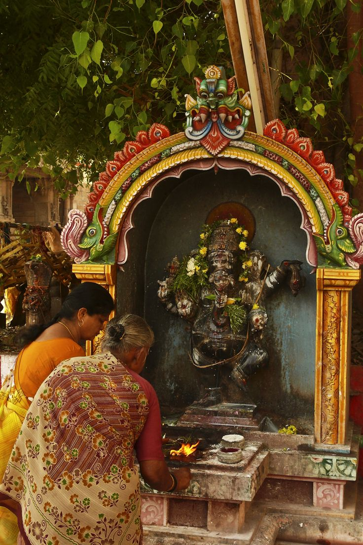 temple offering. madurai. india. love the idea of making a sort of temple/shrine pod with flowers and dangles and gold chimes and charms. soho?