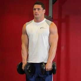 3) Muscle Targeted: Trapezius. Exercise Name: Standing Dumbbell Upright Row.