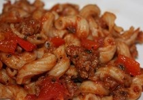 Johnny Marzetti...a school cafeteria staple. I still make this stuff. Its great. I just brown ground beef, add ragu and cooked elbow macaroni. YUM!