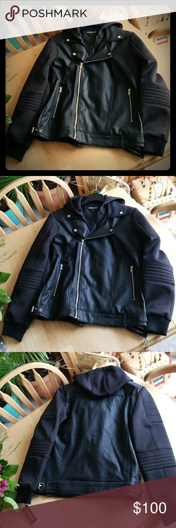 Members Only hooded faux leather biker jacket Hey guys, here's a super cool looking faux leather biker jacket! And it's hooded! Comes in a Mens Medium. Thanks for taking a peek :) Members Only Jackets & Coats