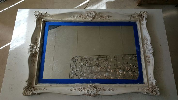This large mirror was a horrible cheap gold color to begin with, painted in Annie Sloan old white, washed with pure white. Then clear and dark waxed for a gorgeous aged antiqued look