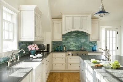 blue green tile backsplash against white kitchen cabinets (Blue Skies and Yellow Dogs)