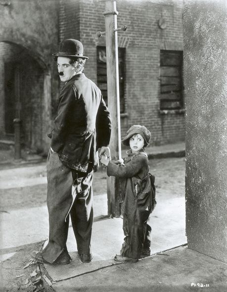 "Charlie Chaplin and Jackie Coogan for Charles Chaplin Productions' ""The Kid"" in 1921. (Unidentified photographer)"