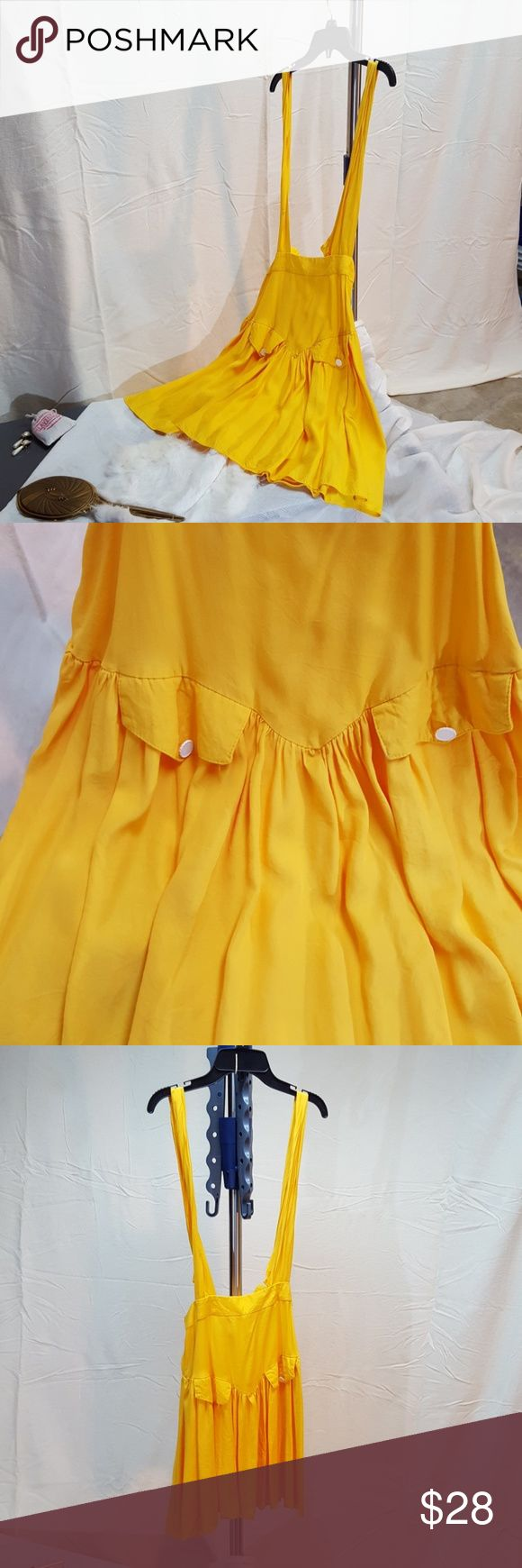 Vintage 80s Yellow Suspender Skirt Vintage yellow drop waist suspender skirt with faux pockets. A lively addition to any wardrobe, this skirt is a great color blocking option. Says size 13 but fits more like a 10/12. In great shape! Skirts Mini