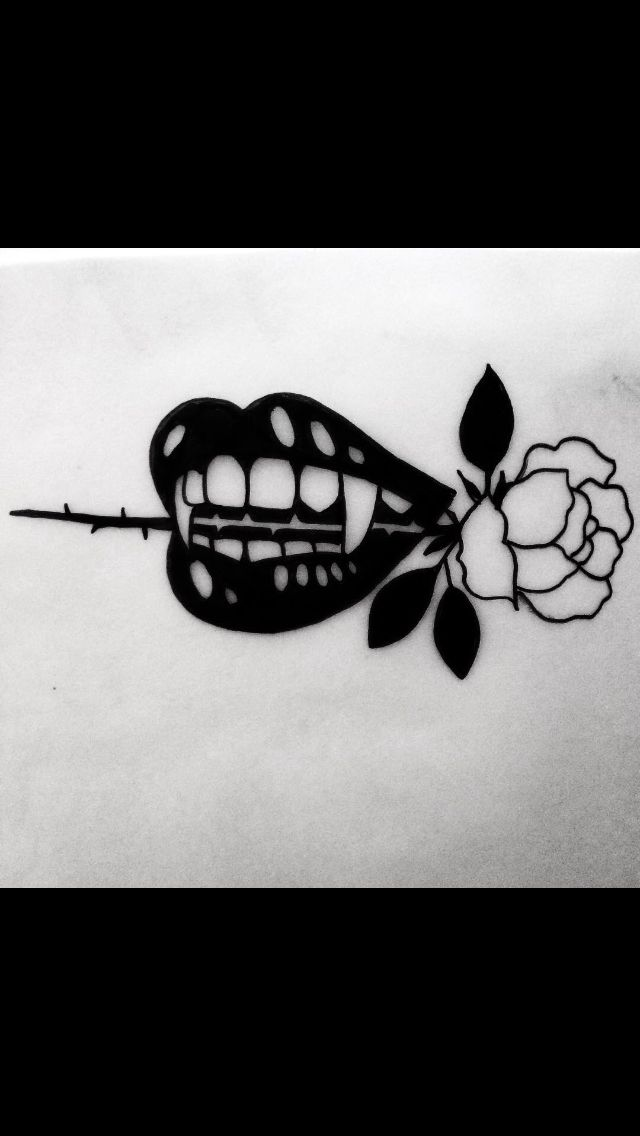 romance tattoo. not to lose the hopeless romantic attitude and to always believe in love. without the weird teeth though