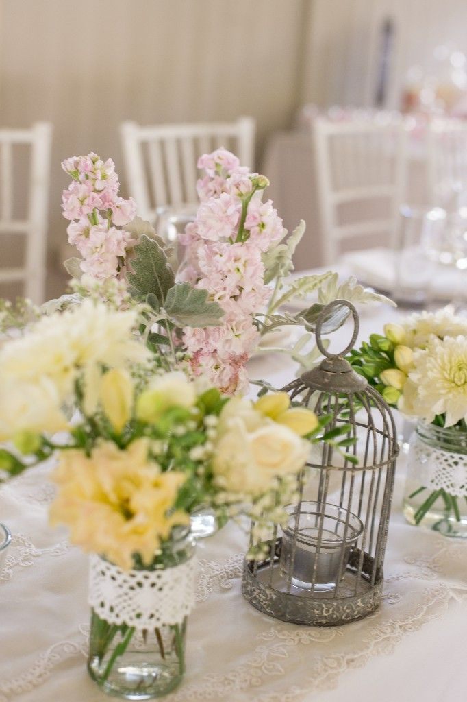 Vintage themed bridal table with soft yellow and pink