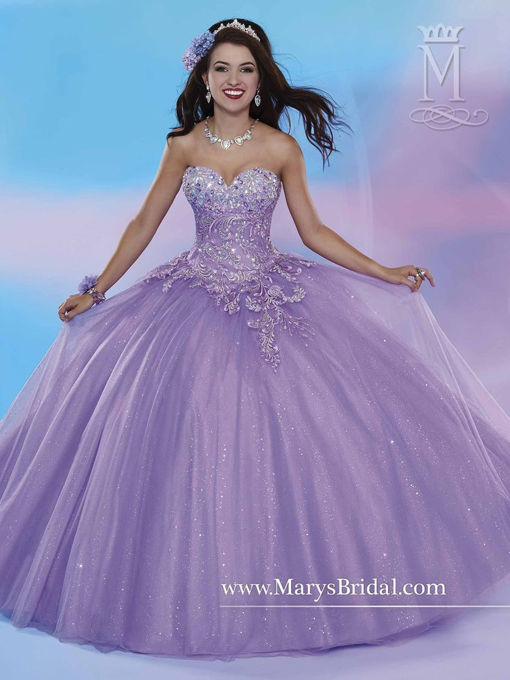 Style 4653 by Mary's is a shimmering tulle quinceanera ball gown with strapless sweetheart neckline, floral bead and embroidery detail on bodice, and lace-up back.