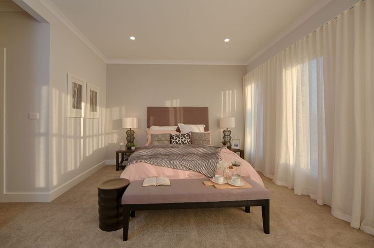 Soft lighting and a light pink throw creates a delicate, feminine touch.
