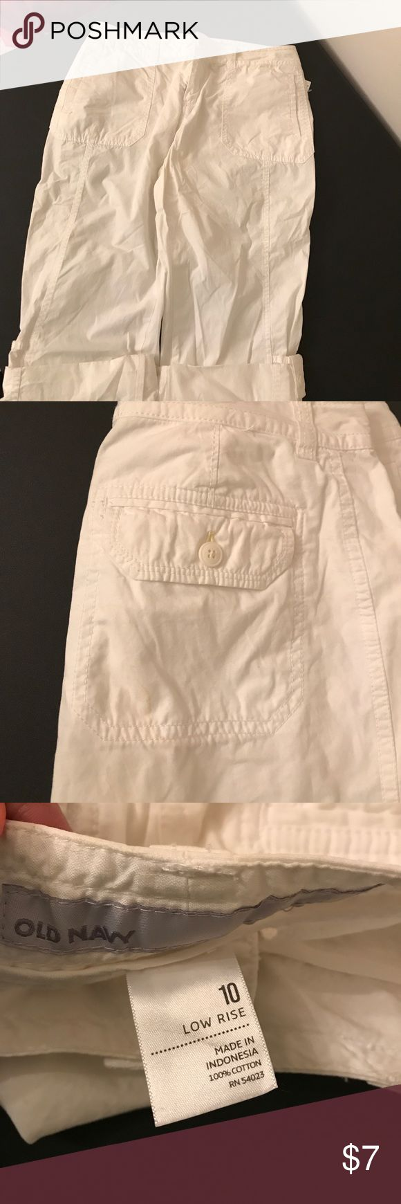 Old Navy capri cargo pants Low rise capris with button detail on the bottoms. Some yellowing due to storage (pictured) Old Navy Pants Capris