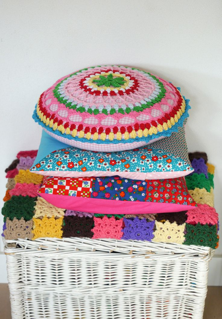 Patchwork cushions and patchwork crocheted blanket - Photo made by www.bonthuishouden.nl