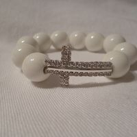 White Cross made with ceramic beads R150.00 #christian #cross #bracelet #beads #isaacsjewellery