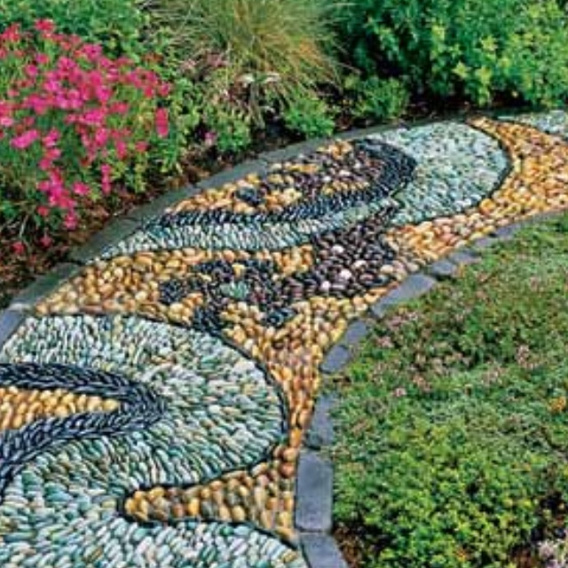 Mosaic rock pathway . Beautiful , would love to do this in my yard.