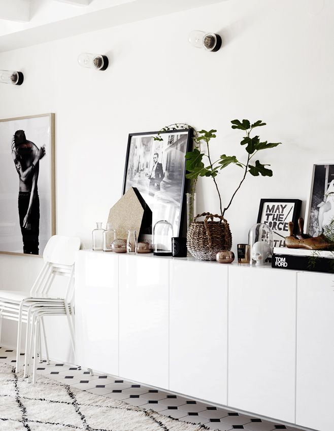 Great blog.  Love how they have used kitchen overhead cupboards as a hanging sideboard