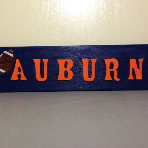 This is a great gift for  yourself  or others who are Auburn College Football Fans. Made from reclaimed wood. The background is painted with an acrylic navy blue paint. Wooden letters painted burnt orange name your favorite team. It's accented with a football decal.  I have a variety of signs. All with different sayings. And all from reclaimed wood. My husband is a building inspector and works with construction workers daily. They throw a a lot of wood in the dumpsters to end up at the du...
