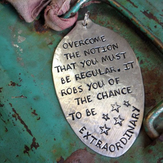 STaMPeD ViNTaGe uPCyCLeD SPooN JeWeLRy PeNDaNT - uTa HaGeN QuoTe - oVeRCoMe THe NoTioN THaT you MuST Be ReGuLaR. iT RoBS you oF THe CHaNCe To