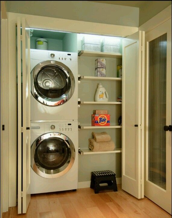 Laundry Closet. The stackable washer & dryer really frees up some room in the tiny space. LOVE THIS!!!!!!