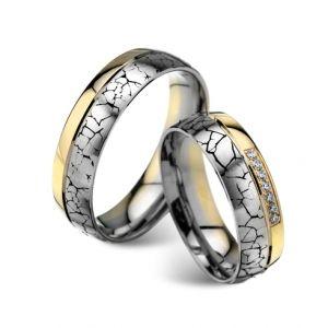 Modele verighete CORIOLAN V604    Verighete din aur alb si aur galben      Latime: 6.00 mm (min 4.8 mm - max 8 mm)     Carate diamante: 0.07 Ct     Greutate aprox.: 12.7 gr/pereche     Timp de livrare: 2 saptamani  Pretul este pentru o pereche de verighete din aur 14K cu diamant si este variabil in functie de marimi. Modelul poate fi comandat pe culorile dorite, deasemenea si in aur de 18K.