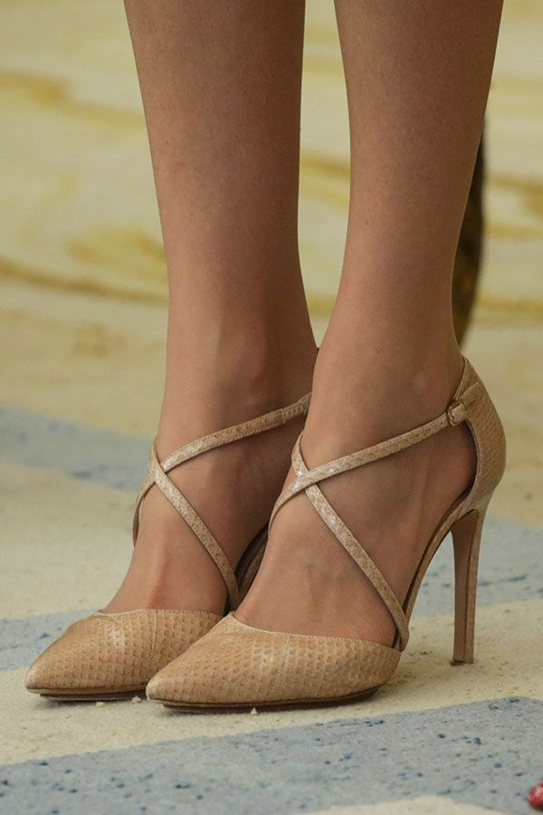 On her feet were a bespoke version of the Magrit 'Laura' pumps. Letizia's shoes feature an embossed snake pattern.