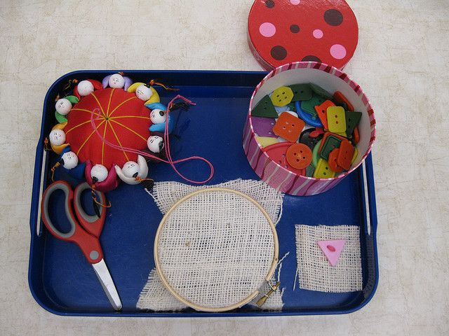 Sewing tray in the Montessori classroom. My dog ate my pincushion like this....must get a new one!