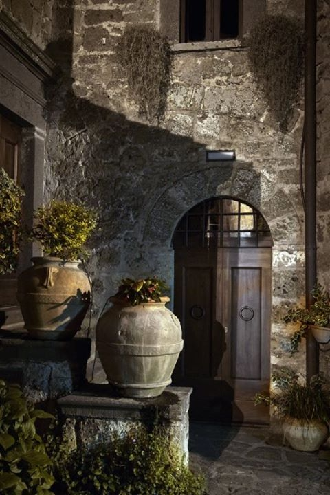 Beautiful Olive Oil-Style Jugs, some used as planters, grace the Entry to this French Country Home.
