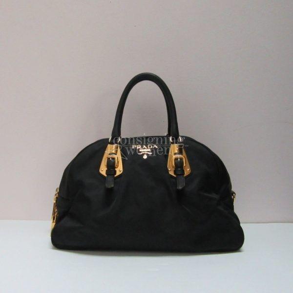 Prada black Tessuto handle bag with gold tone hardware. Shop online.