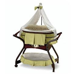 Zen Collection Gliding Bassinet  The beauty and function of this baby bassinet work in harmony to soothe baby. Plush bedding in premium textured fabrics and a beautiful sheer canopy create a soothing environment where baby can enjoy the gliding motion at a speed that's just right. Music, nature sounds or simulated sounds of the womb complement baby's soothing experience while beautiful wood accents and earthy colors of the baby bassinet complement your home décor.