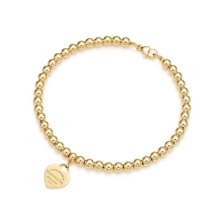 Return to Tiffany® mini heart tag in 18k gold on a bead bracelet.