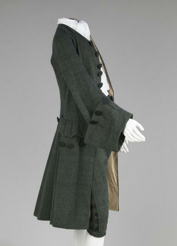 SOURCE: https://en.wikipedia.org/wiki/Frock_coat  IOC: In this image it shows a Frock coat with matching breeches. It has a more Plain, less ornamentation. And you can tell that it is madeof more durable fabrics like serge.