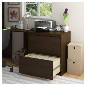 Complete your office space with the Ameriwood Home Presley Lateral File Cabinet. With 2 large file drawers to hold your most important papers, you won't have an issue holding your legal and letter-sized documents. The well-made surface is ideal for displaying photos or other decorative items as well as hosting your printer. Its sleek lines and the medium brown finish of the laminated MDF and particleboard allow this piece to fit in with both modern and traditional decor. The final d...