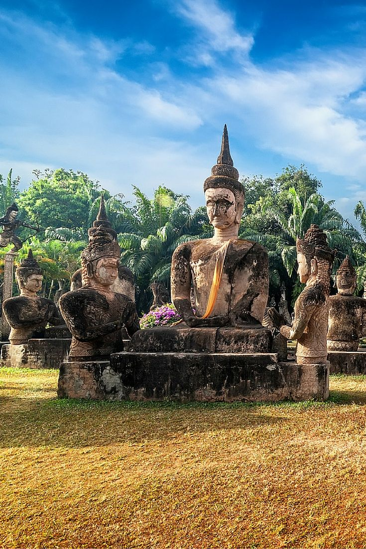 Religious statues at Wat Xieng Khuan Buddha park, Vientiane Laos.  Why you need to discover Laos!! Laos is one of the most beautiful and untouched country in the world. Click through to read more about this incredible country!
