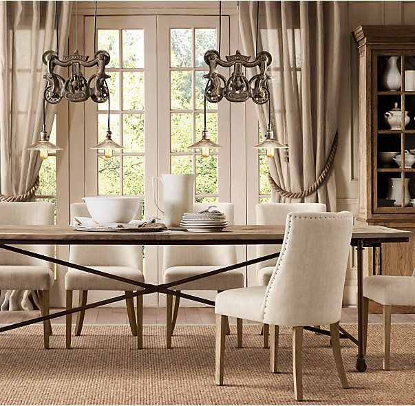 RHs Flatiron Rectangular Dining TableThe Pairing Of Antique Solid Reclaimed Elm Doors And Cast Metal Achieves The Form Meets Function Industrial Appeal