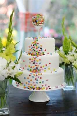 White wedding cake with multicoloured candy detail