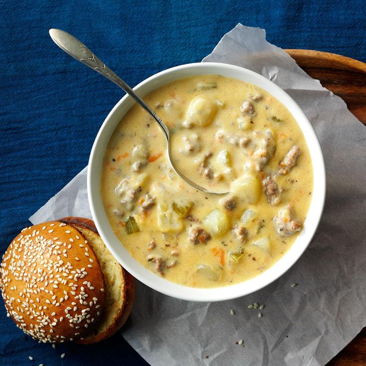 """Cheeseburger Soup Recipe -A local restaurant serves a similar soup but wouldn't share its recipe with me. So I developed my own, modifying a recipe for potato soup. I was really pleased at the way this """"all-American"""" soup turned out. —Joanie Shawhan, Madison, Wisconsin"""